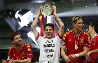 Cesc Fabregas lifts the European Championship trophy in 2012