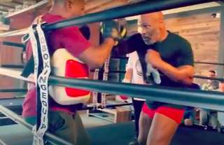 Iron Mike looks in incredible shape as he hammers the pads in training