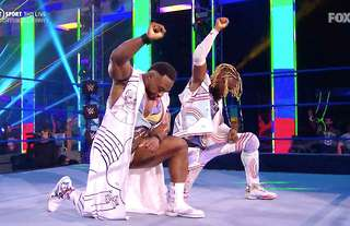 WWE stars Big E and Kofi Kingston take a knee