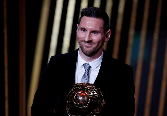 Messi with the Ballon d'Or