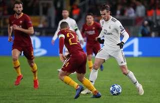Alessandro Florenzi takes on Gareth Bale