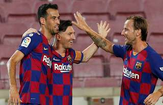 Rakitic with Messi and Busquets