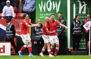 Conor Gallagher celebrates with Charlton players