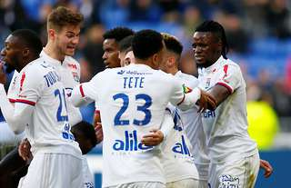 Bertrand Traore celebrates with the Lyon players