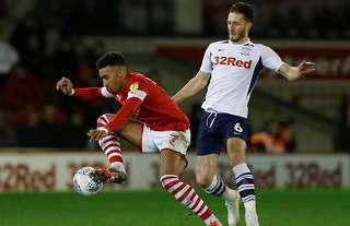Ben Davies in action for Preston