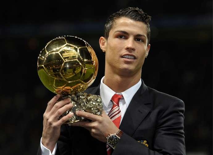 Ronaldo with the Ballon d'Or at Man Utd