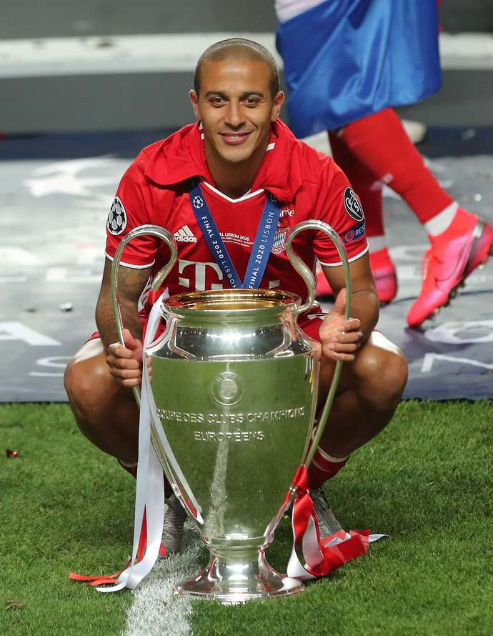 Thiago with the Champions League trophy