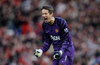 Edwin van der Sar celebrates a Man United goal