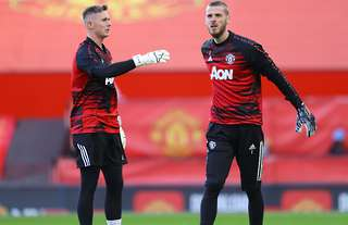 Dean Henderson and David de Gea in action for Man United