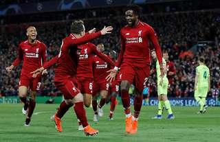 Divock Origi celebrates scoring against Barcelona